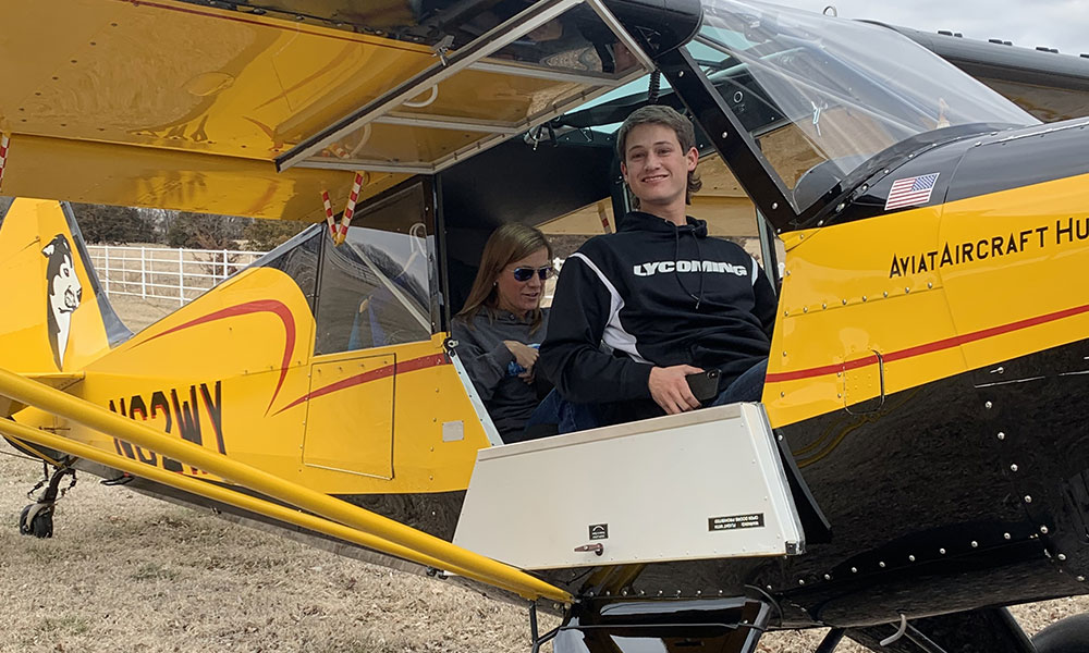 Austin Clemens flying his Mom, Julie, around